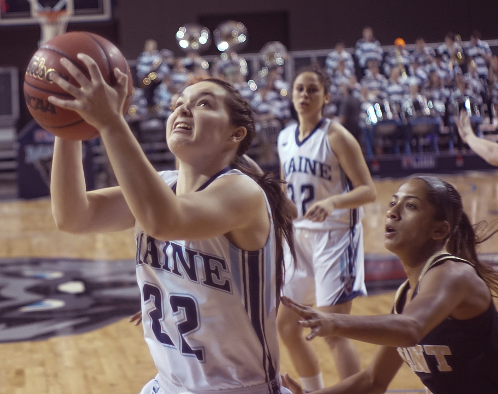 Parise Rossignol of Maine finds room inside for a layup against Bryant. The Black Bears dominated every phase of the game and made up for a loss in the season opener a year ago.