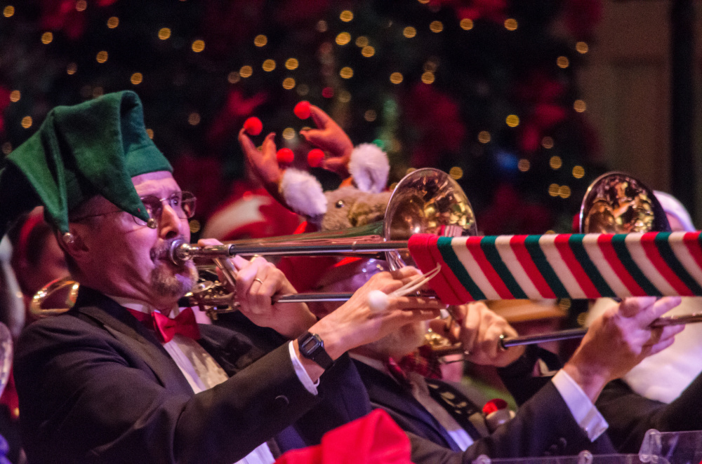A trombone player shows his holiday spirit while playing a Christmas song during the 2014 show.