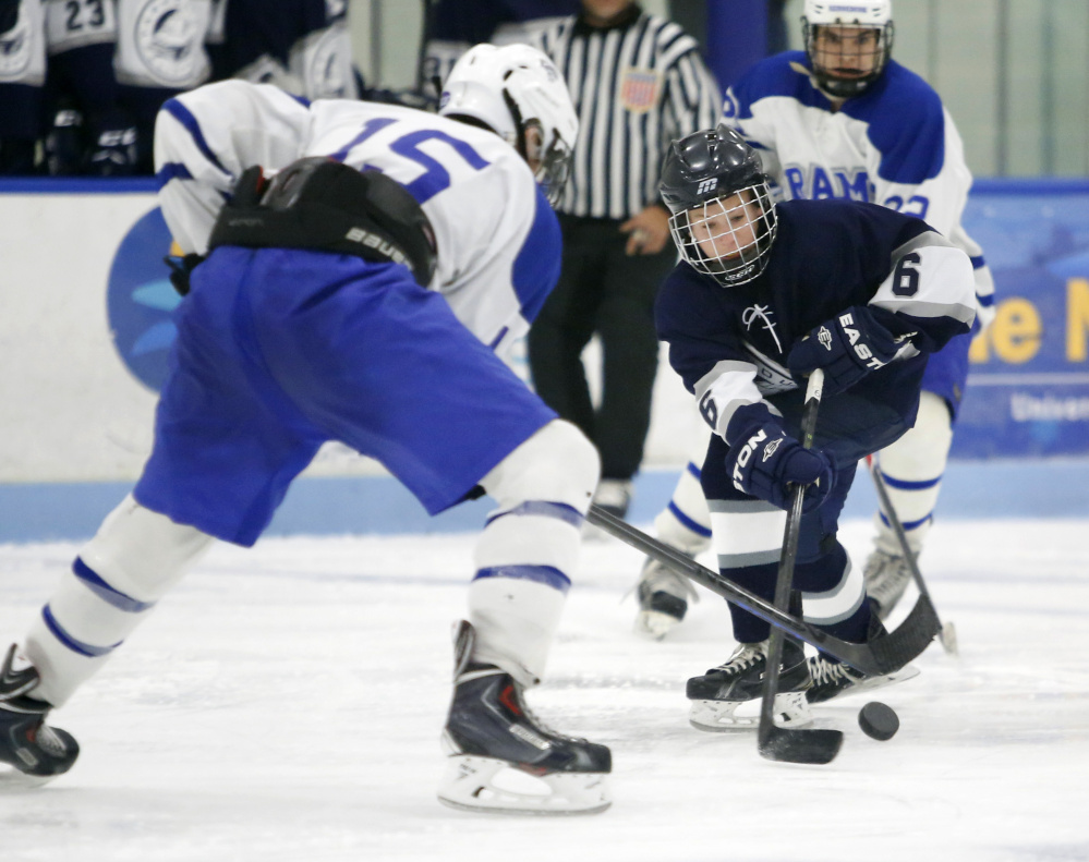 Joe Truesdale, right, of Yarmouth tries to get past Miles Eaton of Kennebunk during Saturday's game in Biddeford.