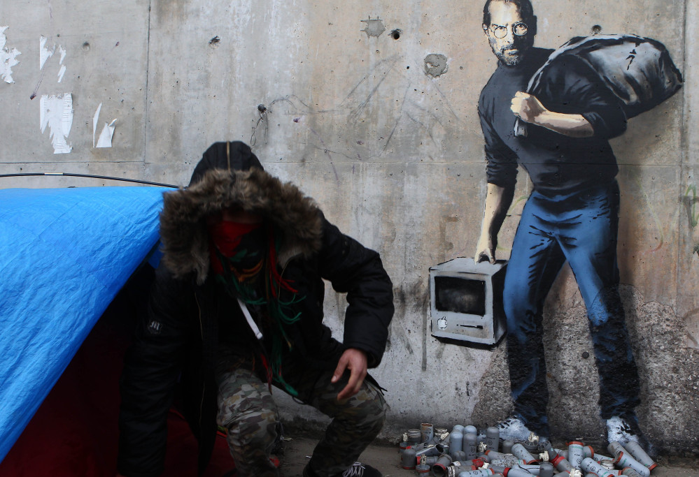 Artist Banksy's mural at a refugee camp pictures Steve Jobs, whose biological father was Syrian, as a migrant.