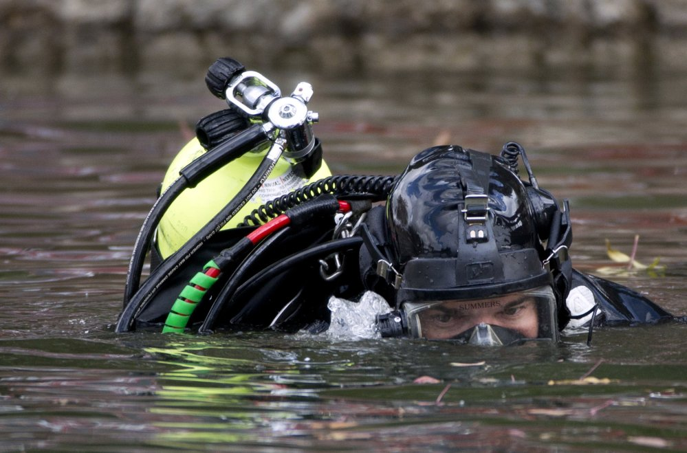 An FBI diver searches Seccombe Lake Friday following leads that Syed Rizwan Farook and Tashfeen Malik visited the area prior to their rampage.