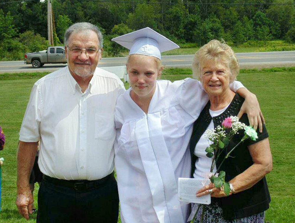 Tanika Hodges poses for a photo with her grandparents, Terry and Mary Hodges, on her graduation day from the Maine Academy of Natural Sciences in August. (Photo courtesy of Tanika Hodges)