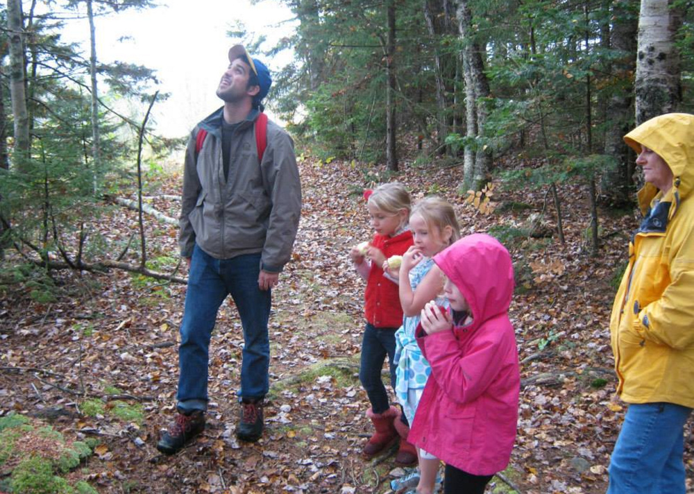 Merryspring Nature Center Director Brett Willard takes a school group on a nature walk at the 66-acre nonprofit refuge in Camden. On Saturday, the center will host a Winter Wassail event to celebrate the winter solstice and the great outdoors.