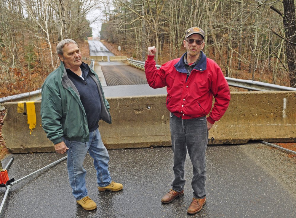 Whitefield residents Norm Best, right, and Jerry Brann agree that the Northy Bridge needs repairs, but said they feel safe on it and see no reason it should be permanently closed.