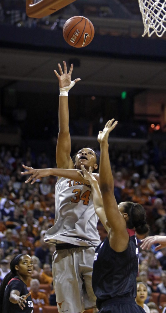 Texas center Imani Boyette shoots against Stanford forward Erica McCall during the first half of the Longhorns' 77-69 win on Sunday in Austin, Texas.