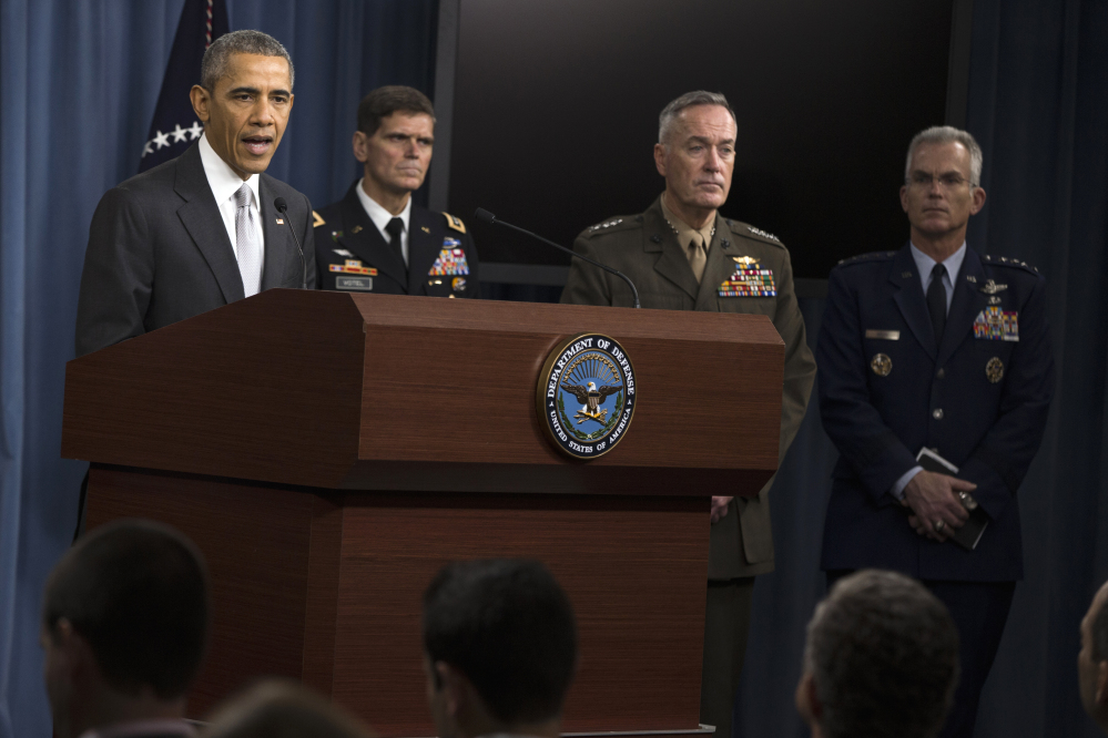 President Barack Obama speaks at the Pentagon on Monday about the fight against the Islamic State group following a National Security Council meeting. Joining the president, from the left are, Commander of U.S. Special Operations Command Gen. Joseph Votel, Joint Chiefs Chairman Gen. Joseph Dunford, and Joint Chiefs Vice Chairman Gen. Paul Selva.