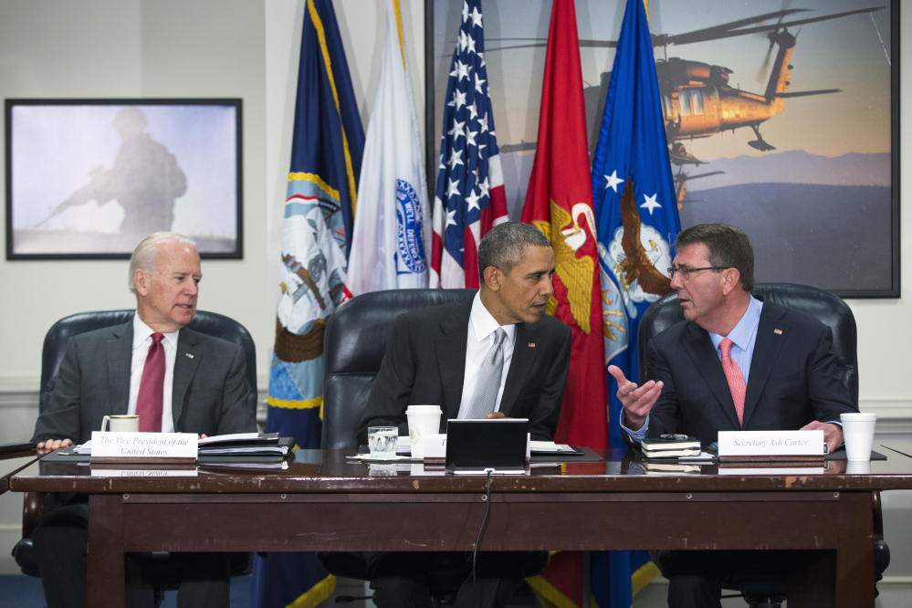 President Barack Obama talks with Vice President Joe Biden and  Defense Secretary Ash Carter during a meeting with the National Security Council about the fight against the Islamic State group Monday at the Pentagon.