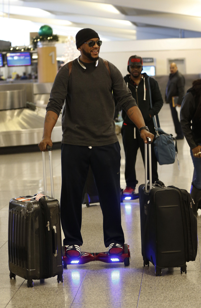 Carlos Dean rides on a hoverboard at Hartsfield- Jackson Atlanta International Airport on Friday in Atlanta. Almost a dozen airlines, including Delta, American and United, said Thursday they are banning hoverboards because of the potential fire danger from the lithium-ion batteries that power the devices.