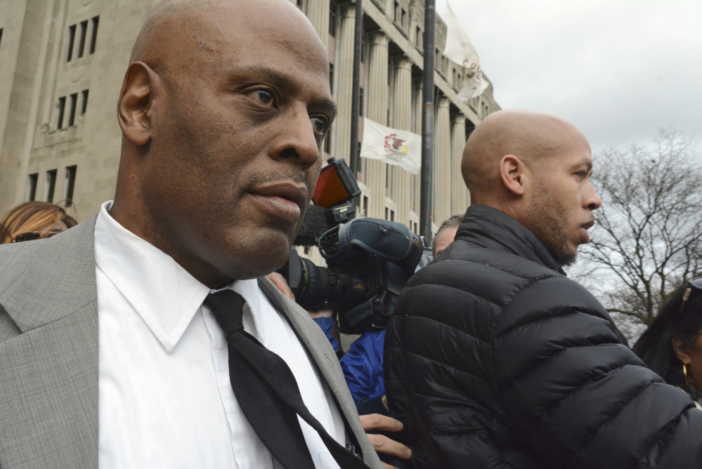 Chicago Police Cmdr. Glenn Evans, left, leaves the Cook County courthouse Monday after being acquitted of shoving his gun down a suspect's throat in 2013.