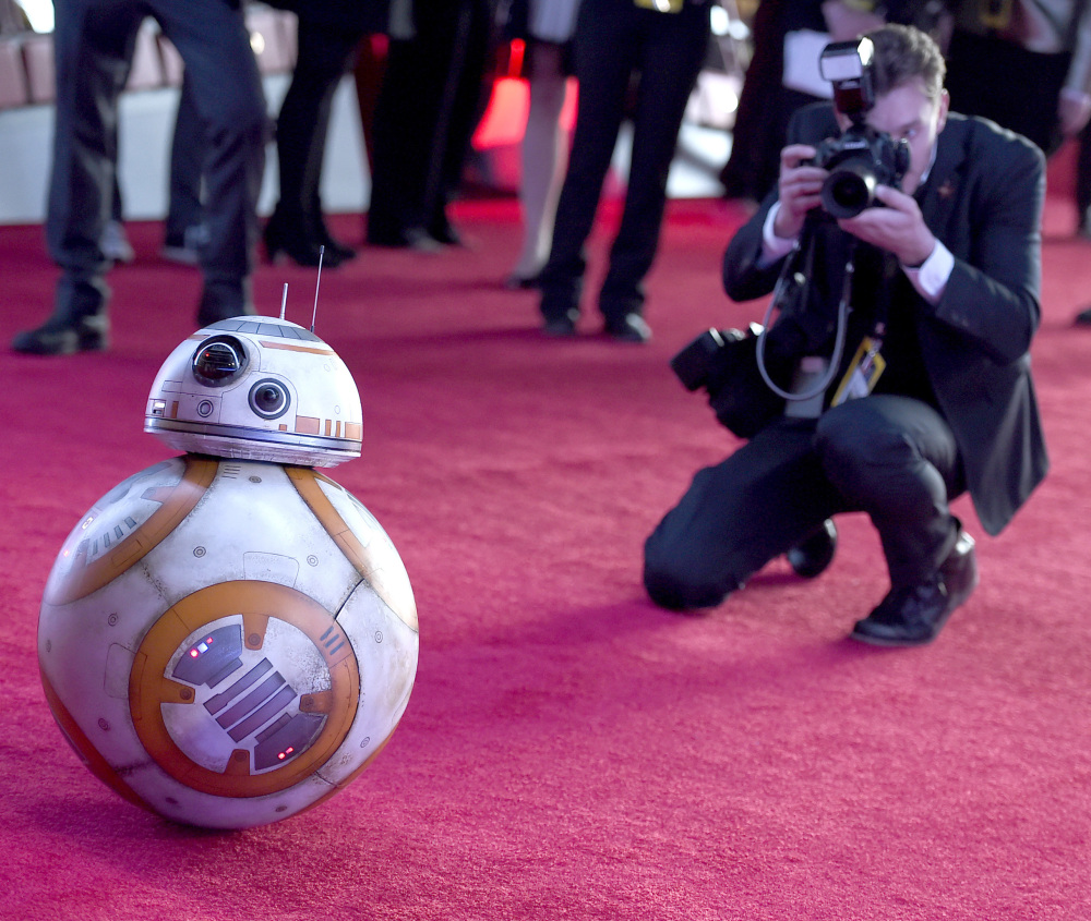 "Film character BB-8 arrives at the world premiere of ""Star Wars: The Force Awakens"" in Los Angeles on Monday at what could be the largest movie premiere event in history."