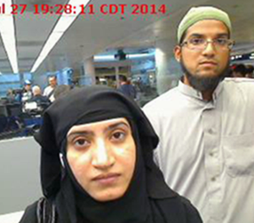 Tashfeen Malik, left, and Syed Farook pass through O'Hare International Airport in Chicago. The pair were the shooters in the San Bernardino attacks.