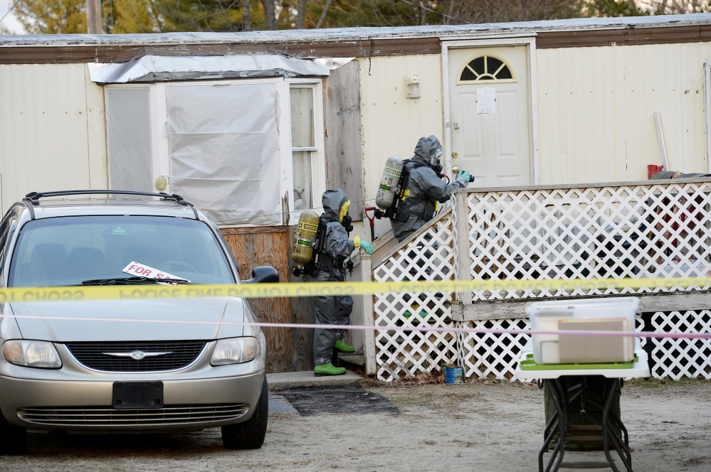 Members of the Maine Drug Enforcement Agency approach the home at 125 Old Thompson Road in Buxton on Tuesday to investigate a possible methamphetamine lab.