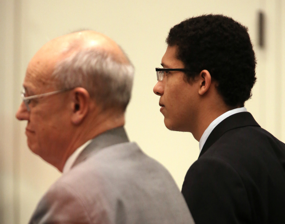 Philip Chism, right, stares straight ahead beside defense attorney John Osler as the jury reads the verdict Tuesday in his trial in Salem Superior Court. Chism was convicted in the 2013 murder and rape of Colleen Ritzer, a 24-year-old math teacher at Danvers High School.