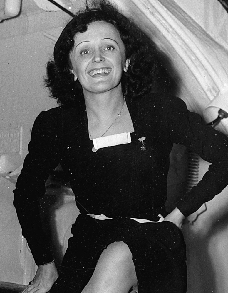 Parisian singer Edith Piaf poses aboard the Queen Elizabeth as she arrives in New York City on Oct. 16, 1947.