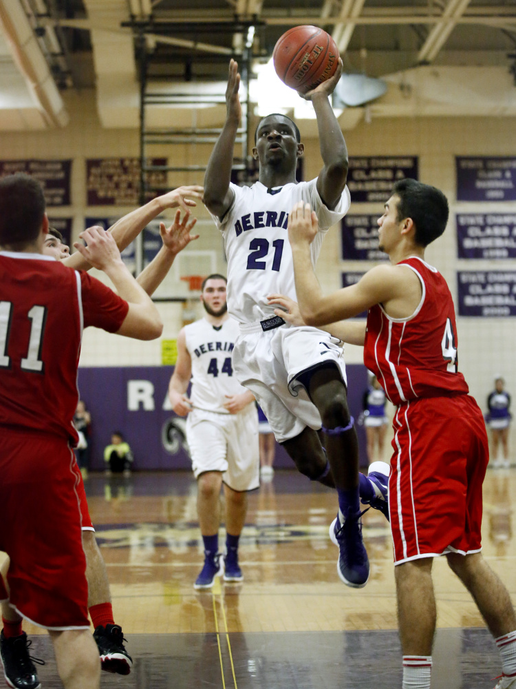Deering's Ben Williams drives to the basket past Sanford's Tye Laviolette during the Rams' 67-38 win Tuesday in Sanford. Williams scored 27 points.