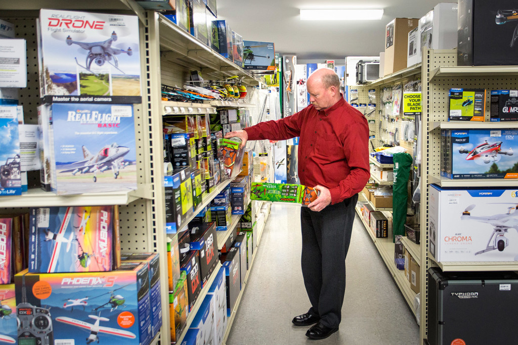 Peter McLaughlin of Benton looks over the quadcopter drones at Ray & Robin's Hobby Center in Falmouth on Monday. The store's staff has started handing out letters with all purchases explaining the impact of the FAA's new registration rule. Gabe Souza/Staff Photographer