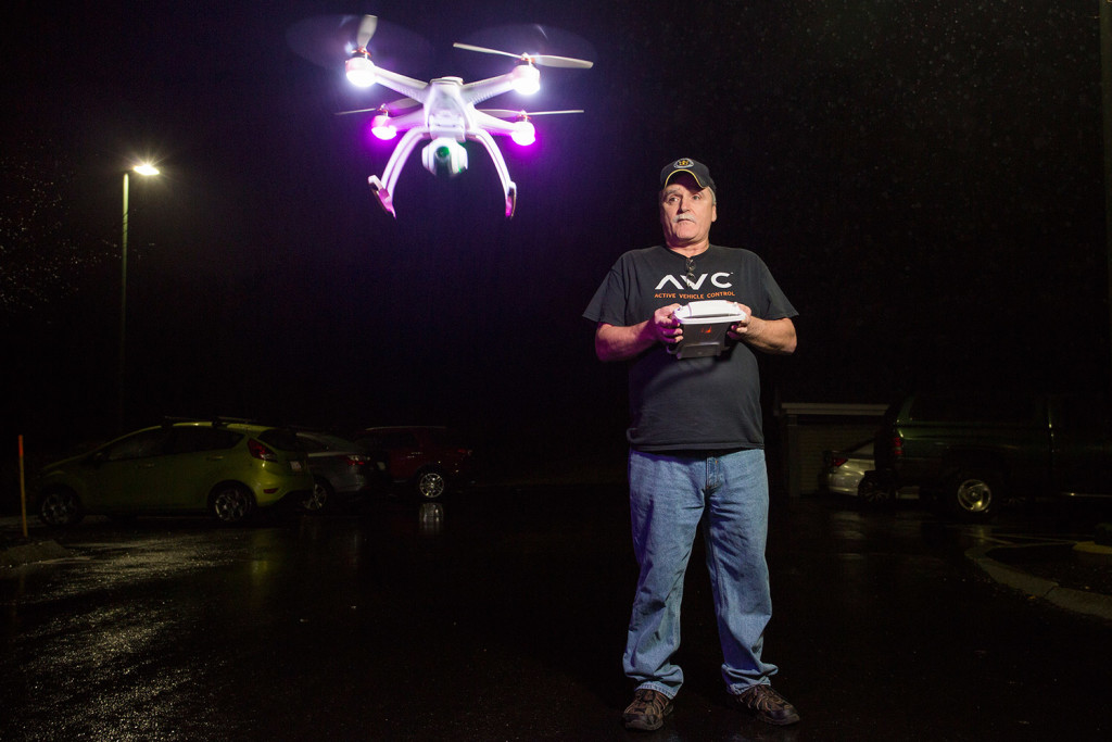 Burt Dumond, part-owner of Ray & Robin's Hobby Center in Falmouth, flies a Blade Chroma Camera Drone in the parking lot of the store Monday. The Federal Aviation Administration announced that individuals will have to register their drones with the FAA before Feb. 19. Gabe Souza/Staff Photographer