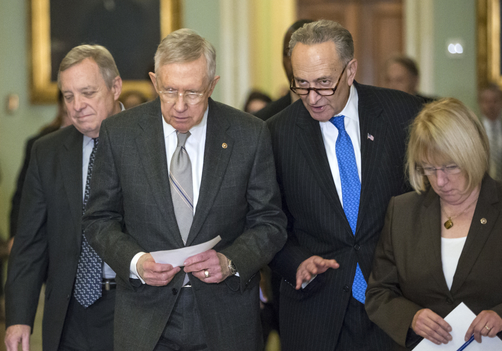 Senate Minority Whip Richard Durbin, D-Ill., from left, Senate Minority Leader Harry Reid, D-Nev., Sen. Charles Schumer, D-N.Y., and Sen. Patty Murray, D-Wash., leave a Democratic caucus lunch Tuesday.