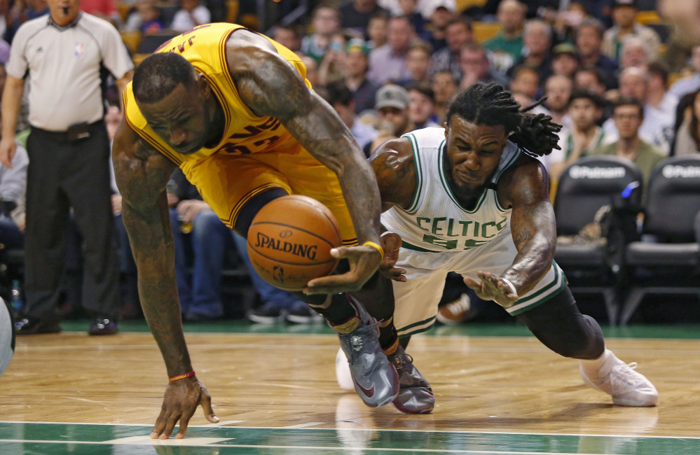 LeBron James scoops the ball away from the Celtics' Jae Crowder on a play in the first quarter. James led Cleveland with 24 points.
