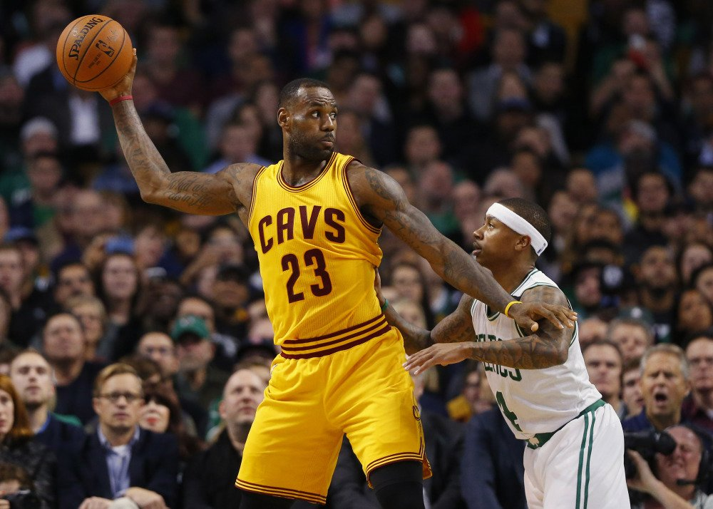 LeBron James holds the ball away from Celtics guard Isaiah Thomas in the second quarter of Tuesday night's game in Boston. Celeveland came away with an 89-77 win.