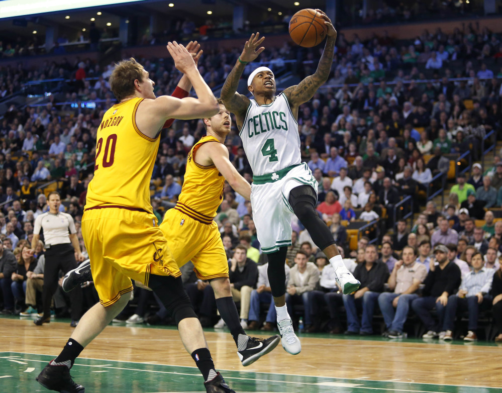 The Celtics' Isaiah Thomas drives past the Cavaliers' Timofey Mozgov (20) and Matthew Dellavedova in the first quarter.