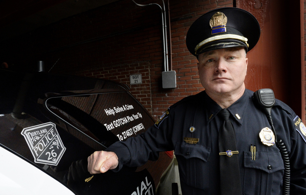 "Portland police Lt. Robert Doherty shows the cruiser decal – Badge No. 26 – that memorializes Officer Charles McIntosh, the first in Portland to be killed in the line of duty. ""It's a reminder that your service ... will not be forgotten,"" Doherty said."