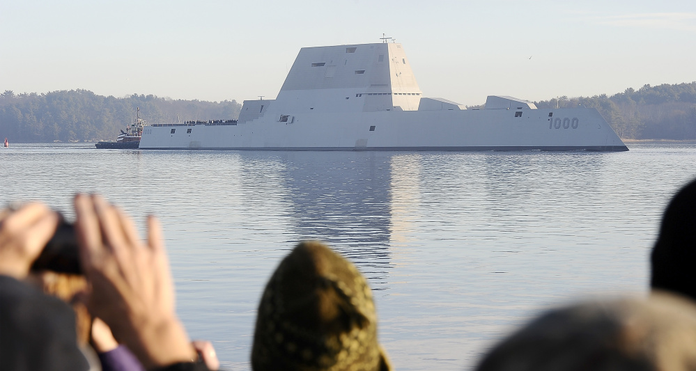 A crowd watches as the Zumwalt launches from Bath Iron Works on Dec. 7 for sea trials and heads down the Kennebec River to the ocean at Popham Beach.