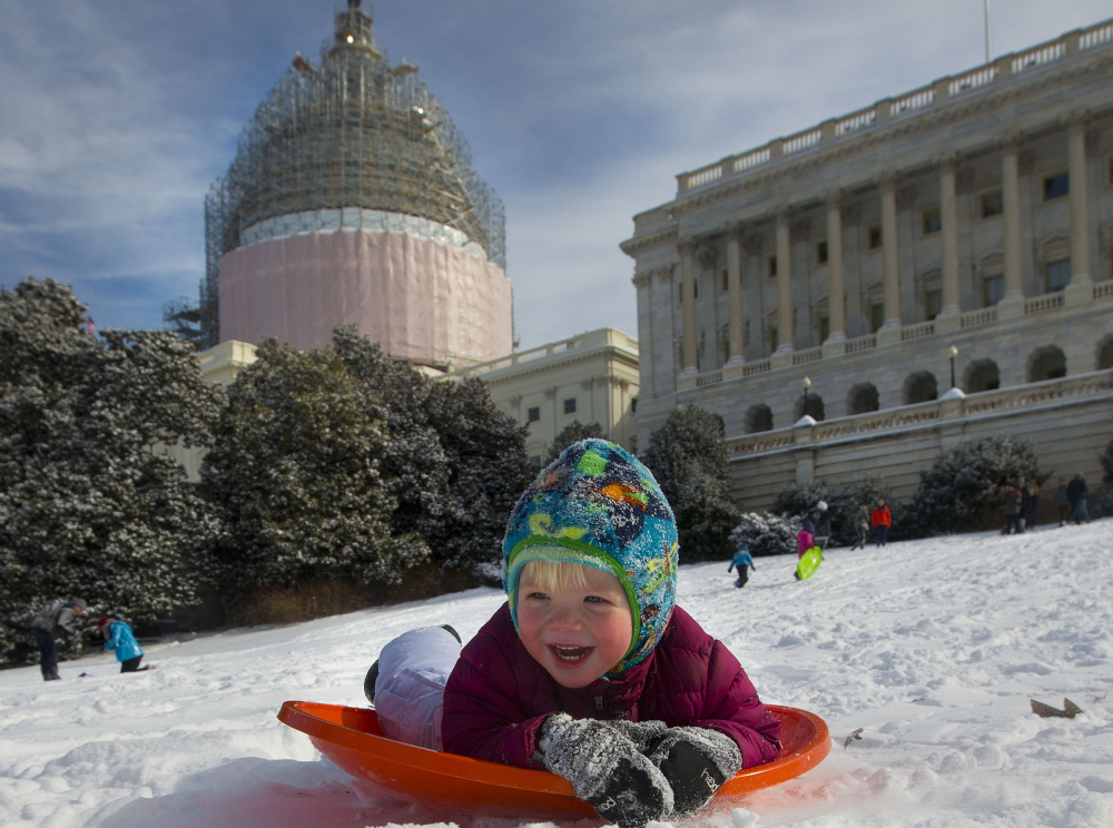 James Drobnyk, 2, takes a run on Capitol Hill last winter.