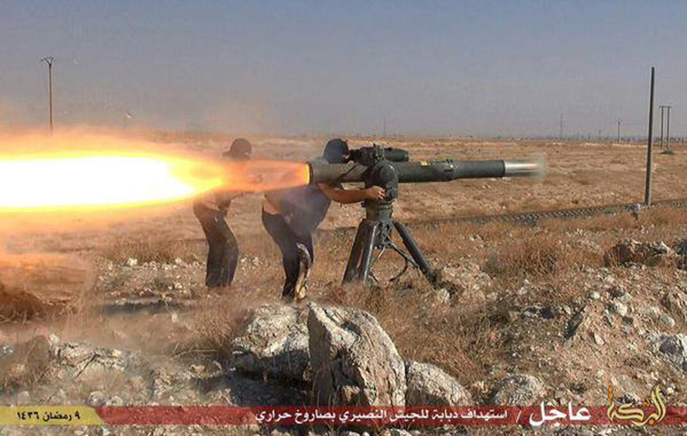 In this photo posted on an anonymous website, Islamic State militants fire an anti-tank missile in Hassakeh, northeast Syria.