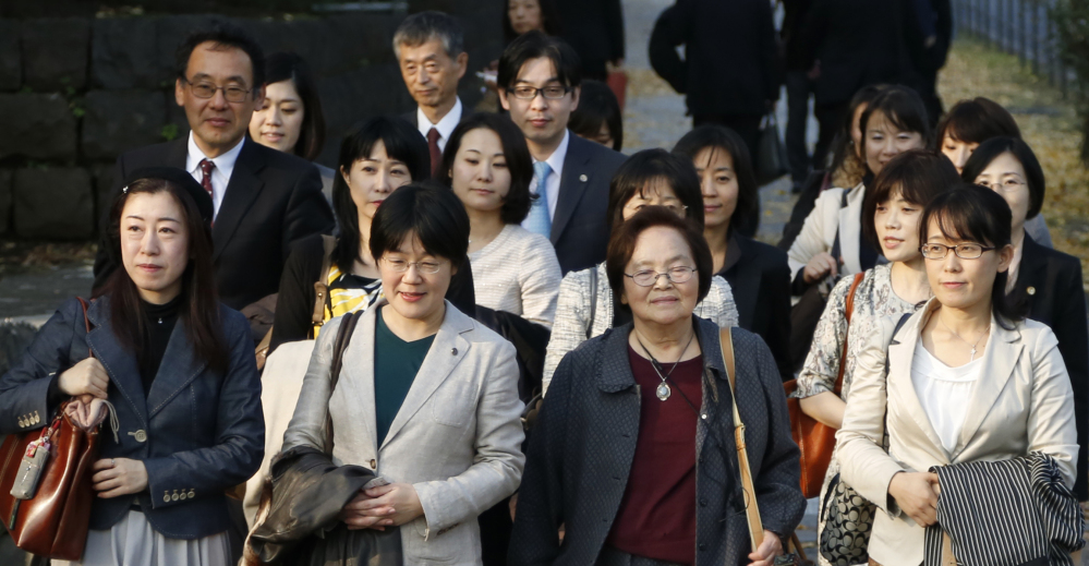 Plaintiffs and their supporters walk to Japan's Supreme Court in Tokyo on Wednesday.