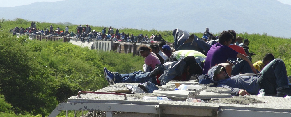 People trying to reach the U.S. ride atop a freight train in 2014. Figures for 2015 show unaccompanied minors are crossing  the U. S. Southwest border in larger numbers.