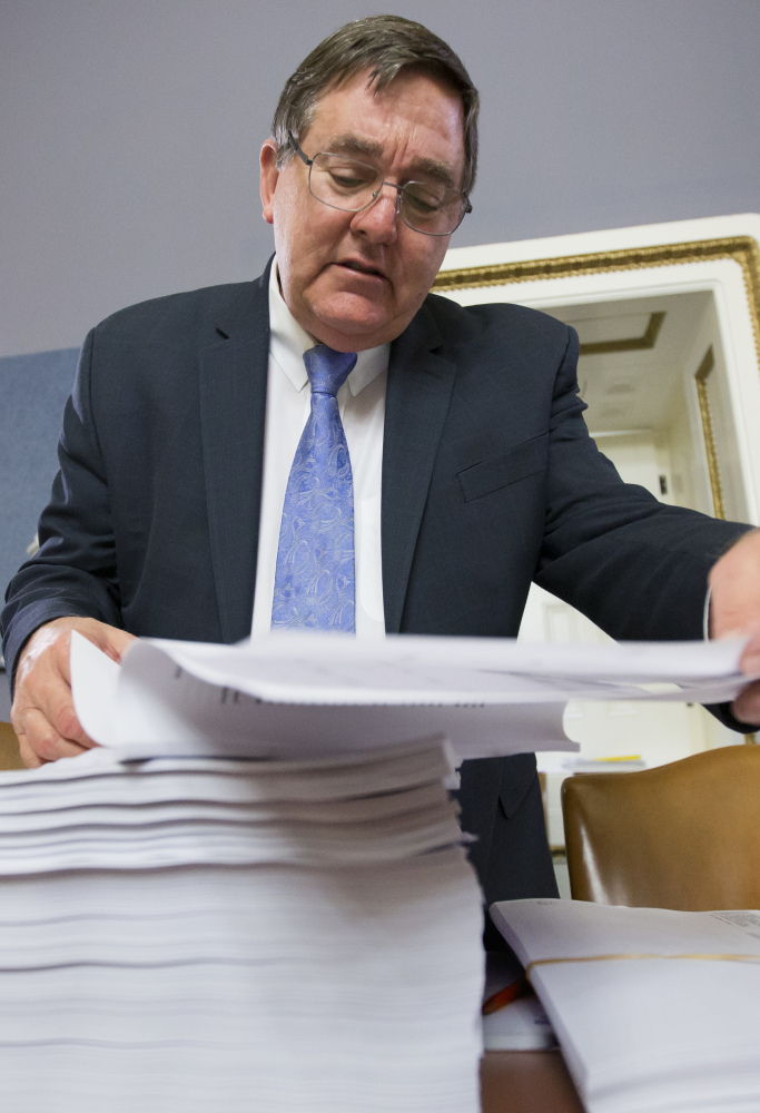 Rep. Michael C. Burgess, R-Texas, with a printout of the $1.1 trillion spending bill to fund the government for 2016.