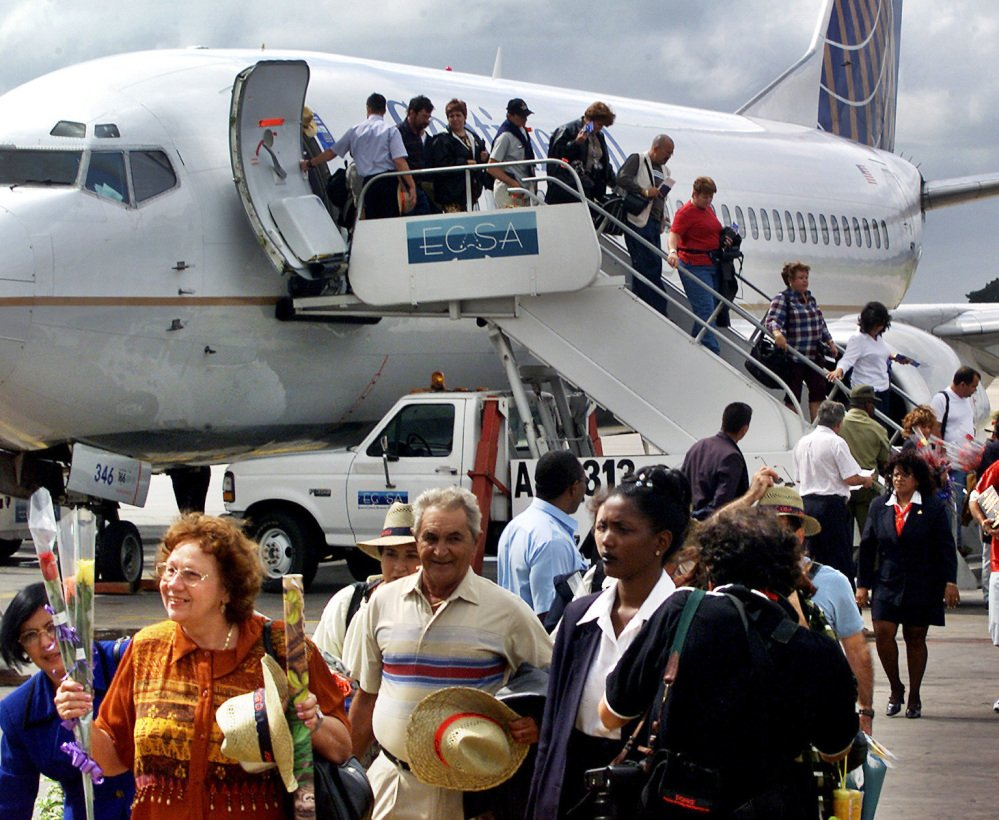 Passengers on the first flight of Continental Airlines from Miami to Havana arrive at Jose Marti International Airport on Nov. 1, 2001. The U.S. and Cuba say an aviation deal is near.