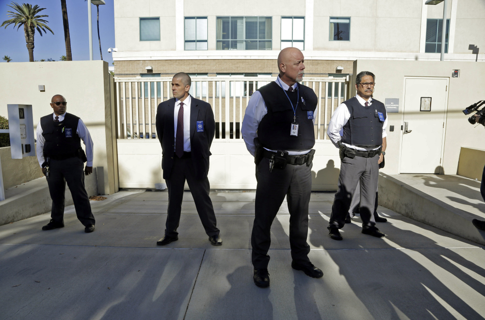 Security is tight after Enrique Marquez's arrival Thursday at U.S. District Court in Riverside, Calif. Marquez, a longtime friend of Syed Farook, was charged with conspiring with Farook in 2011 and 2012 to commit terrorism, and with illegally buying two assault rifles that Farook and Tashfeen Malik used in the San Bernardino massacre Dec. 2.