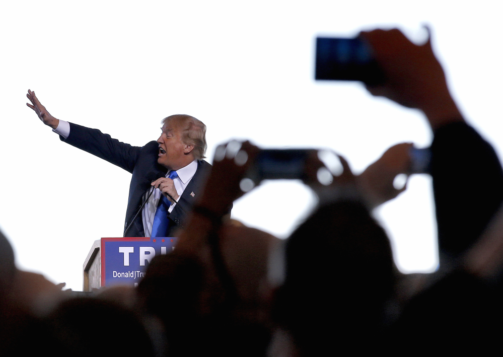 Republican presidential candidate Donald Trump gestures as he speaks at a campaign rally, Wednesday, Dec. 16, 2015, in Mesa, Ariz. (AP Photo/Ross D. Franklin)