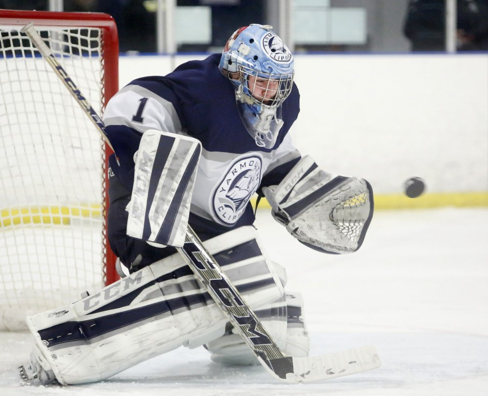 Yarmouth goalie Dan Latham makes a save during the second period Thursday against Cheverus. Yarmouth improved to 4-0 with a 4-3 victory.