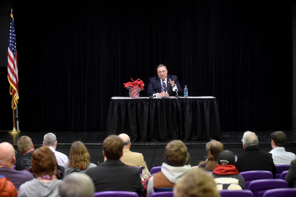 Gov. Paul LePage speaks to people assembled Thursday at Waterville Junior High School for a town hall meeting.