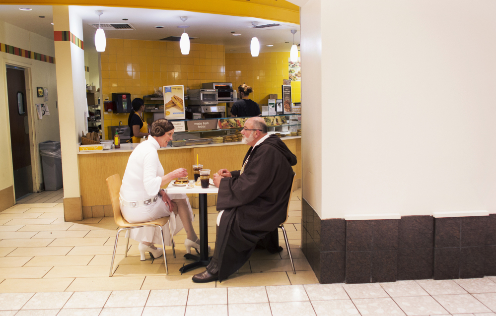 "Bonta and Fred Cunningham, dressed as Princess Leia and Obi-Wan Kenobi, grab something to eat at the MacArthur Center food court in Norfolk, Va., before seeing the showing of ""Star Wars: The Force Awakens"" on Thursday."