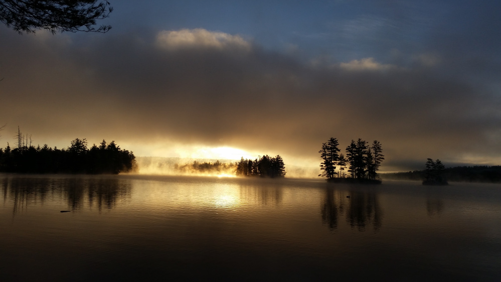 Thompson Lake in Otisfield has never looked so dramatic in her nearly 20 years of shorefront living, says Robin Sayre of Casco, and this photo makes it hard to contest her statement.