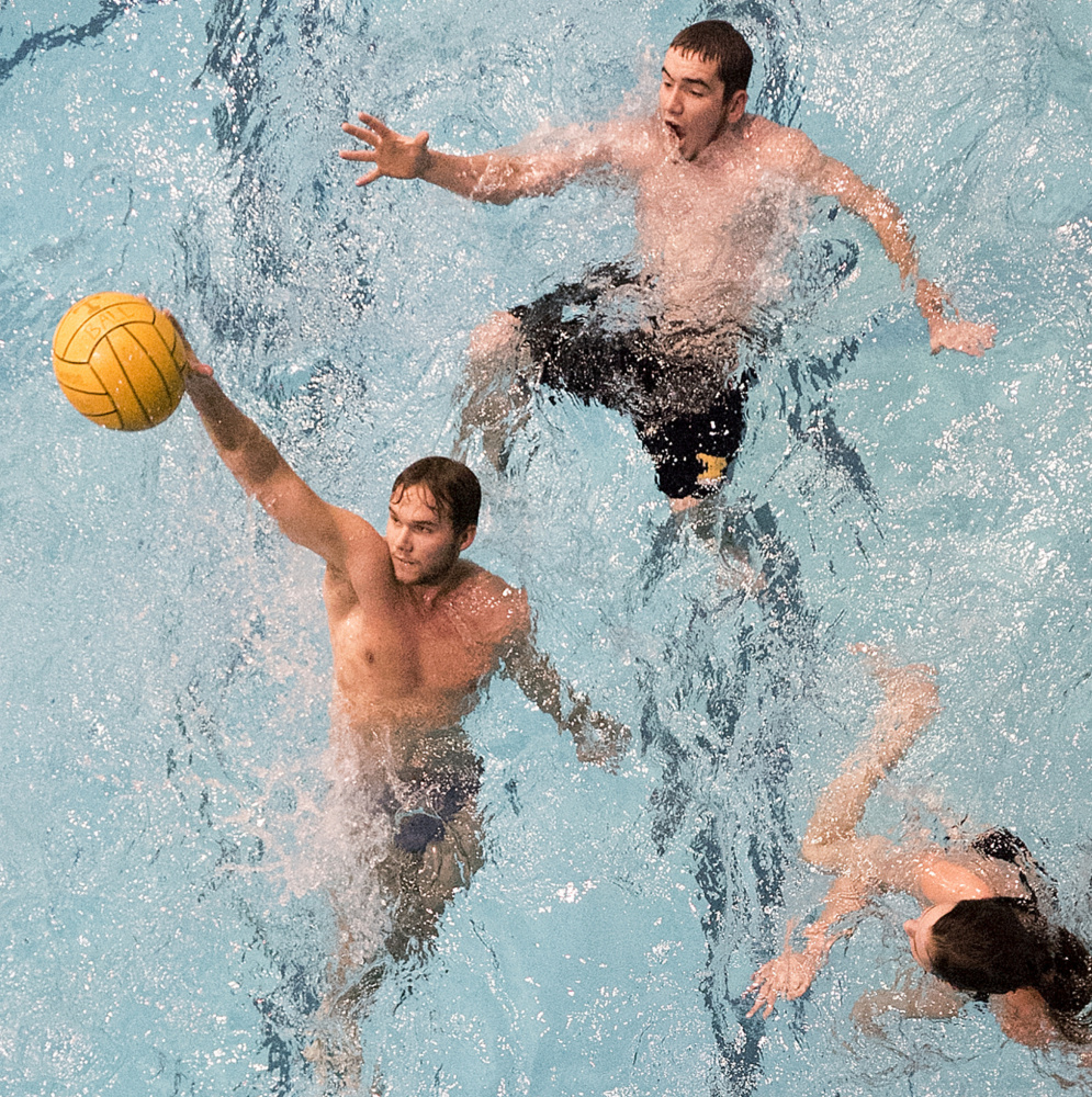 He shoots, maybe he scores ... that's water polo aficionado Constantin Scherelis taking dead aim while Chris Pyke, top, and Alyssa Gilmour tread water during a practice session. What's water polo like? Like rugby in the water, some players say.