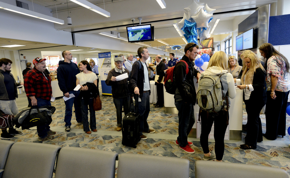 Passengers line up to board the first Elite Airways flight to Florida from the Portland International Jetport on Friday. The state draws 67.4 million domestic visitors a year, a representative from Visit Florida says. Shawn Patrick Ouellette/Staff Photographer