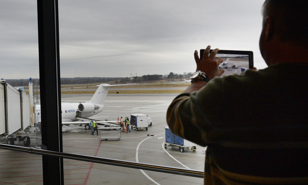 David Laliberte of Palm Bay, Fla., photographs the Elite Airways jet he rode to Portland on Friday. Florida is the top destination for Maine travelers, with 325.6 passengers per day heading to the Sunshine State.