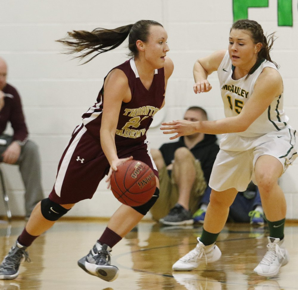Thornton Academy's Isabella Robinson drives against Brooke Howard of McAuley during a Class AA South showdown Friday night. McAuley won the rematch of last year's Western Class A final, 41-31.