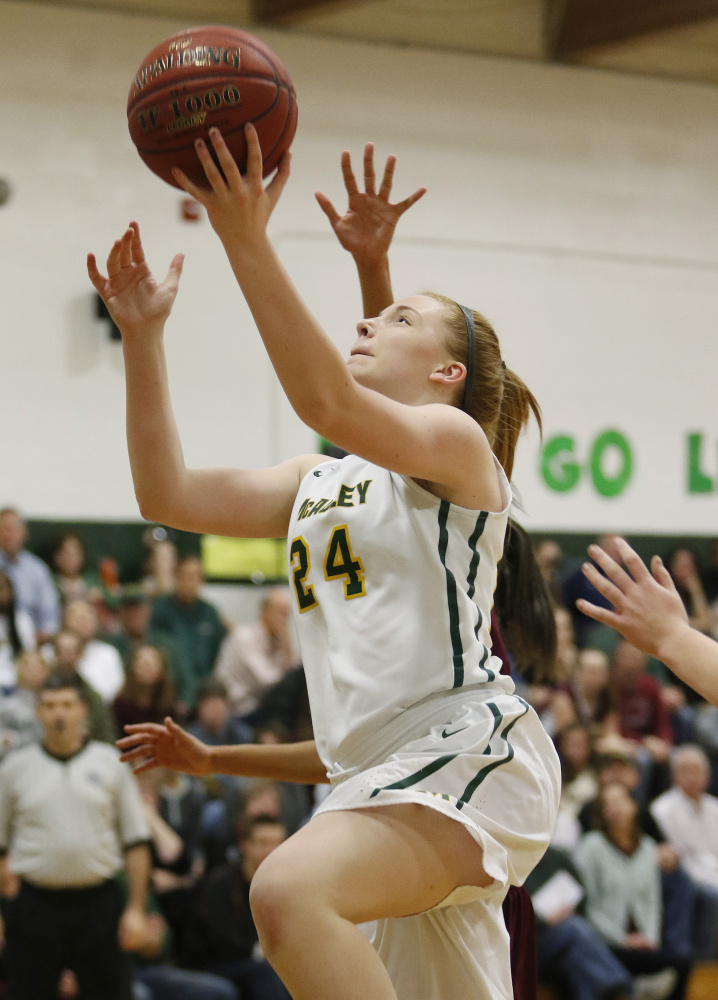 McAuley's Eva Mazur goes in for a layup in the second quarter Friday night against Thornton Academy. The Lions improved to 5-0 and handed Thornton its first loss. Joel Page/Staff Photographer