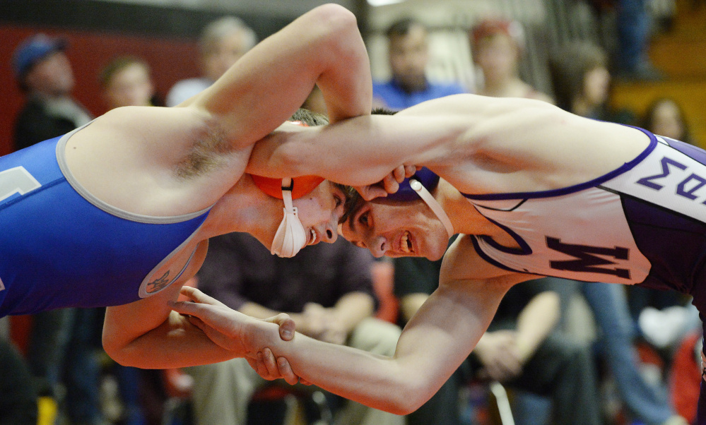 Eddie Deroche of Mountain Valley, left, and Aiden Whitis of Marshwood wrestle in the 145-pound final at the Altantic Invitiational on Saturday at Wells High School. Whitis was one of five Marshwood wrestlers to win titles and the Hawks won the team title.