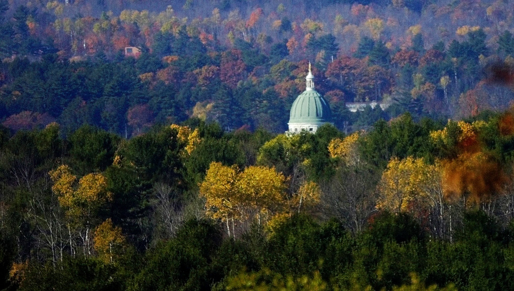 Howard Hill looms in this view of the State House from Route 17 in Augusta. An effort to preserve the 164-acre tract for public use is in line to receive $337,500 in taxpayer funds as part of the Land for Maine's Future program.