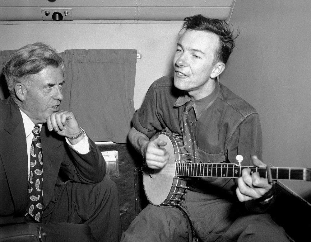Henry A. Wallace, Progressive Party presidential hopeful, listens to Pete Seeger in August 1948. The FBI released more than 1,700 pages of documents about Seeger in 2014.