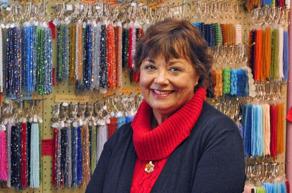 Linda LaCroix, owner of Beads on the Kennebec in Augusta, sends customers to other Water Street businesses to support them.