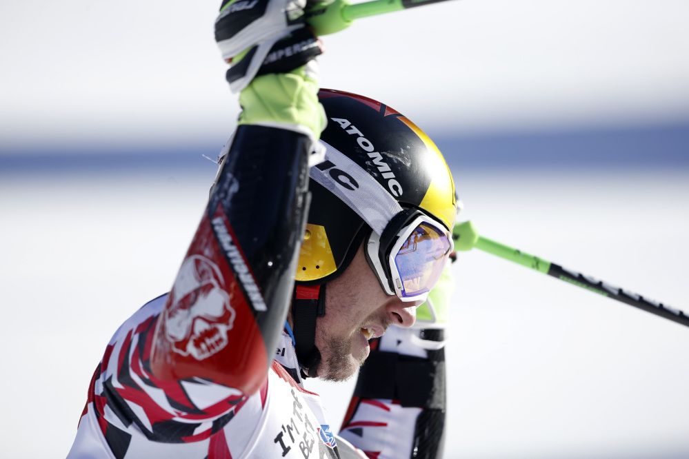 Austria's Marcel Hirscher celebrates in the finish area after winning the World Cup giant slalom Sunday in Alta Badia, Italy.
