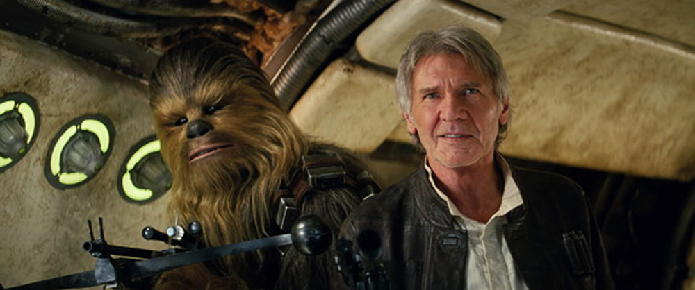"Peter Mayhew as Chewbacca and Harrison Ford as Han Solo in ""Star Wars: The Force Awakens."" Studio estimates on Sunday say ""Star Wars: The Force Awakens"" brought in a galactic $238 million over the weekend, making it the biggest North American debut of all time."
